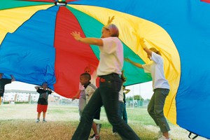 People playing a parachute game